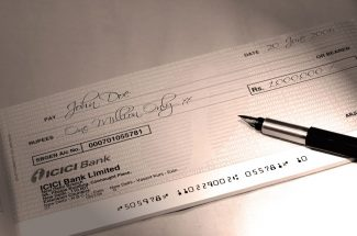 penalty of banks on cheque bounce